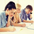 Tired students with notebooks at school — Stock Photo #52478233
