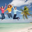 Group of smiling young women jumping in air — Stock Photo #52484893