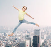 Smiling little girl jumping — Stock Photo