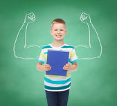 Smiling little student boy with blue book — Foto de Stock