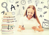 Girl with tablet pc and books at school — Stock Photo