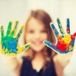 Girl showing painted hands — Stock Photo #52593525