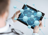 Close up of doctor with stethoscope and tablet pc — Stock Photo