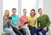 Smiling students with tablet pc computer — Stock Photo