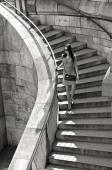 Woman in sunglasses and dress walking down stairs — Stock Photo