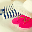 Close-up of beach bag, hat and flip-flops on bed — Stock Photo #52694145