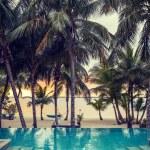 Swimming pool on tropical beach — Stock Photo