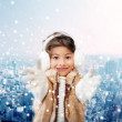 Smiling little girl in winter clothes — Stock Photo #52695887