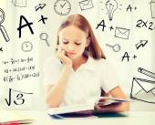 Student girl studying at school — Stock Photo