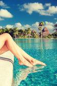 Closeup of woman legs at swimming pool — Stock Photo