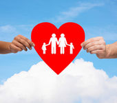 Couple hands holding red heart with family — Stock Photo
