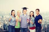 Group of students with diploma showing thumbs up — Stok fotoğraf