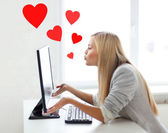Woman sending kisses with computer monitor — Stock Photo