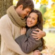Smiling couple hugging in autumn park — Stock Photo #52752035