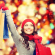 Asian woman in winter clothes with shopping bags — Stock Photo #52919479