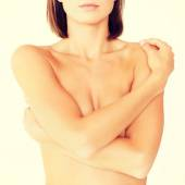 Woman with perfect skin and hands over breast — Stock Photo