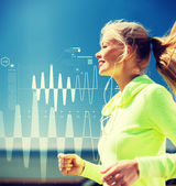 Smiling woman doing running outdoors — Stock Photo