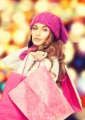 Woman in winter clothes with pink shopping bags — Foto de Stock