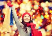 Asian woman in winter clothes with shopping bags — Stock Photo