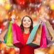 Woman in red dress with colorful shopping bags — Stock Photo #52923865