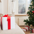 Gift box on coach at home — Stock Photo #52926355