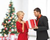 Smiling man and woman with present — Stock Photo