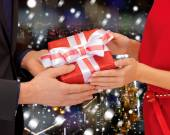 Close up of man and woman with present — Stock Photo