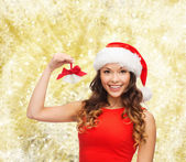Smiling woman in santa helper hat and jingle bells — Stock Photo