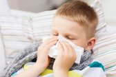 Ill boy with flu at home — Stock Photo