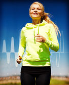 Smiling woman jogging outdoors — Stock Photo