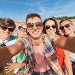 Group of smiling friends making selfie outdoors — Stock Photo #53079849