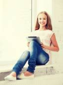 Girl with tablet pc at school — Stock Photo