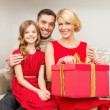 Happy family opening gift box — Stock Photo #53136493