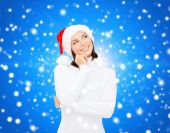 Thinking and smiling woman in santa helper hat — Stock Photo