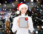 Woman in santa helper hat with tablet pc — Stock Photo