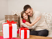 Smiling father and daughter hugging — Stock Photo