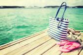 Close up of beach accessories on wooden pier — Stock Photo