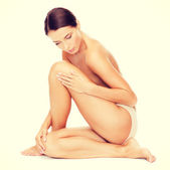 Beautiful naked woman touching her legs — Stock Photo