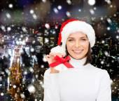 Smiling woman in santa helper hat and jingle bells — Stock Photo