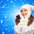 Smiling young woman in white winter clothes — Stock Photo #53411557
