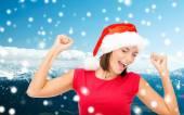 サンタ ヘルパー帽子の女性の笑みを浮かべてください。 — ストック写真