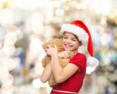 Smiling girl in santa helper hat with teddy bear — Stok fotoğraf