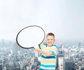 Smiling little boy with blank text bubble — Stock Photo