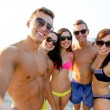 Group of smiling friends making selfie on beach — Stock Photo #53555465