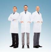 Group of smiling male doctors in white coats — Stock Photo