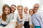 Happy family making selfie at home — Stock Photo