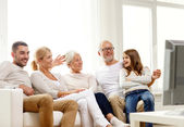 Happy family watching tv at home — Stock Photo