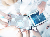 Group of doctors with tablet pc and clipboard — Stock Photo