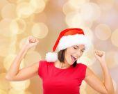 Smiling woman in santa helper hat — Stock Photo