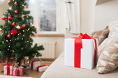 Gift box on coach at home — Stock Photo